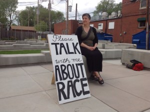 """Jennifer in a St. Louis pocket park with the """"Please Talk With Me About Race"""" sign."""